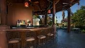 Open-air semi-circular bar at Maji Pool Bar