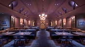 A seating area with a chandelier, booths, tables, chairs and candles