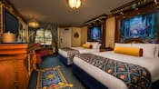 Royal beds, tall elaborate headboards, decorative throws and pillows, elegant dresser, curtained window