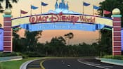 A banner identifies the entrance to Walt Disney World Resort, where dreams come true