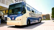 Front view of a blue and white bus called 'Disney's Magical Express'