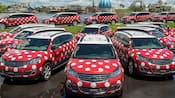 Several polka-dotted SUVs parked along the Disney Springs waterfront