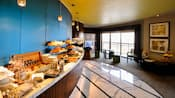 Hotel buffet table with assorted pastries, condiments and baked goods