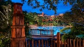 The Uzima Pool area at Disney's Animal Kingdom Lodge, lit up at night