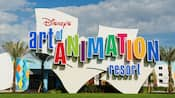 The colorful logo and building exterior of Disney's Art of Animation Resort
