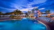 The Bay Lake Tower pool and waterslide at sunset