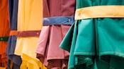 Row of brightly colored sun umbrellas outside Cape May Café in Disney's Beach Club Resort