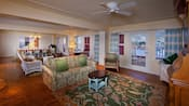 View of the spacious living and dining areas in a Disney Grand Villa