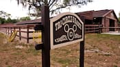 A wooden sign for the Tri-Circle-D Ranch