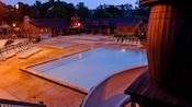 Swimming pool at Disney's Fort Wilderness Resort, lit up at night