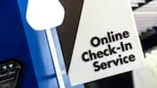 A sign, sticking out from a wall, that reads 'Online Check-In Service'