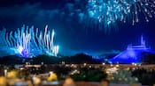 Fireworks burst in the sky over Space Mountain and Cinderella Castle