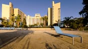 A sandy beach with chaise lounges at Disney's Contemporary Resort