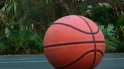 A basketball sits on the court