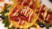 Poke on fried wonton crackers streaked with sauce
