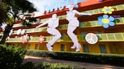 Giant cut-outs of a man and woman doing the 'twist' adorn the side of Disney's Pop Century Resort