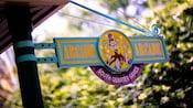 A sign post reads 'Arcade, South Quarter Games'