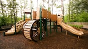 A playground with slide and giant wheel at Disney's Port Orleans – Riverside