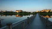 A long bridge across a lake leading to Disney's Saratoga Springs Resort & Spa