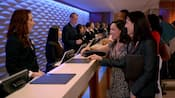 Cast Members assist Guests at the Lobby Concierge desk