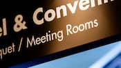 Close-up of an overhead sign for the Resort's Convention Center and Meeting Rooms