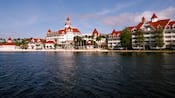 A midday view of Disney's Grand Floridian Resort & Spa from Seven Seas Lagoon