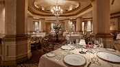 The lavish dining room at Victoria and Albert's restaurant, with tables set with fine china