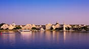 View from the lake at Disney's Yacht Club Resort under a clear blue sky