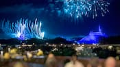 Fireworks bursting over Cinderella Castle and Space Mountain