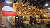Large wooden hull of a fishing boat suspended from the ceiling at Boatwright's Dining Hall