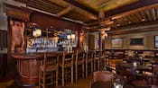 Western frontier-inspired lounge resembles an old-time saloon with painting of elk on the walls and wood carvings of bears flanking the bar