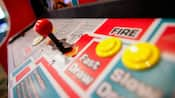 Close-up of brightly colored controls on an arcade game