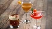 3 unique cocktails atop a wood table