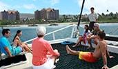 Attendees enjoying a catamaran ride at Disneys Aulani Resort in Hawaii