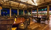 The interior of Ama Ama Beachside Restaurant at Aulani Resort features an open ceiling design
