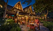 The exterior of the Olelo Room at Aulani Resort features Polynesian themed architecture