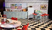 A set design emulating a nineteen fifties style kitchen