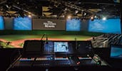 A sound and visual engineering studio, a baseball field set with studio seating, and a large monitor that says, Disney Meetings and Events