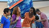 Attendees smiling by Mission Space in Epcot