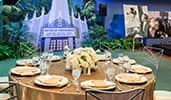 An event space with table and decor themed like the Golden era of Hollywood