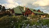 The exterior of Disney's Wilderness Lodge, featuring a design reminiscent of National Park lodges
