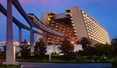 The exterior of Disney's Contemporary Resort features a monorail and a modern design