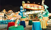 DinoLand USA, a festive dinosaur themed carnival atmosphere