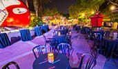 Cocktail tables set up in the courtyard outside of the Rock n Roller Coaster Starring Aerosmith