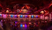 Pizze Rizzo transformed into an event space with an area for dancing surrounded dining tables