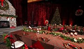 A room decorated in a Christmas theme with a holiday tree, wreath and a long dining table
