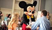 Mickey Mouse meeting attendees in a conference room