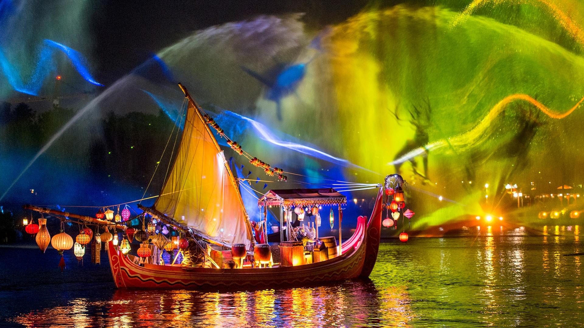 Uma embarcação flutua na água sob uma colorida apresentação de animais