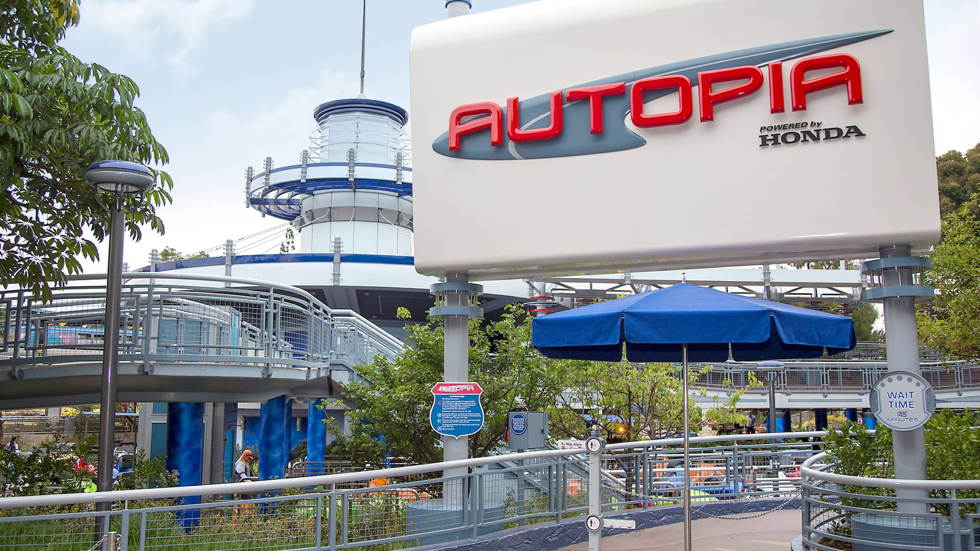 The new, Honda sponsored Autopia sign stands over the entrance of this iconic attraction