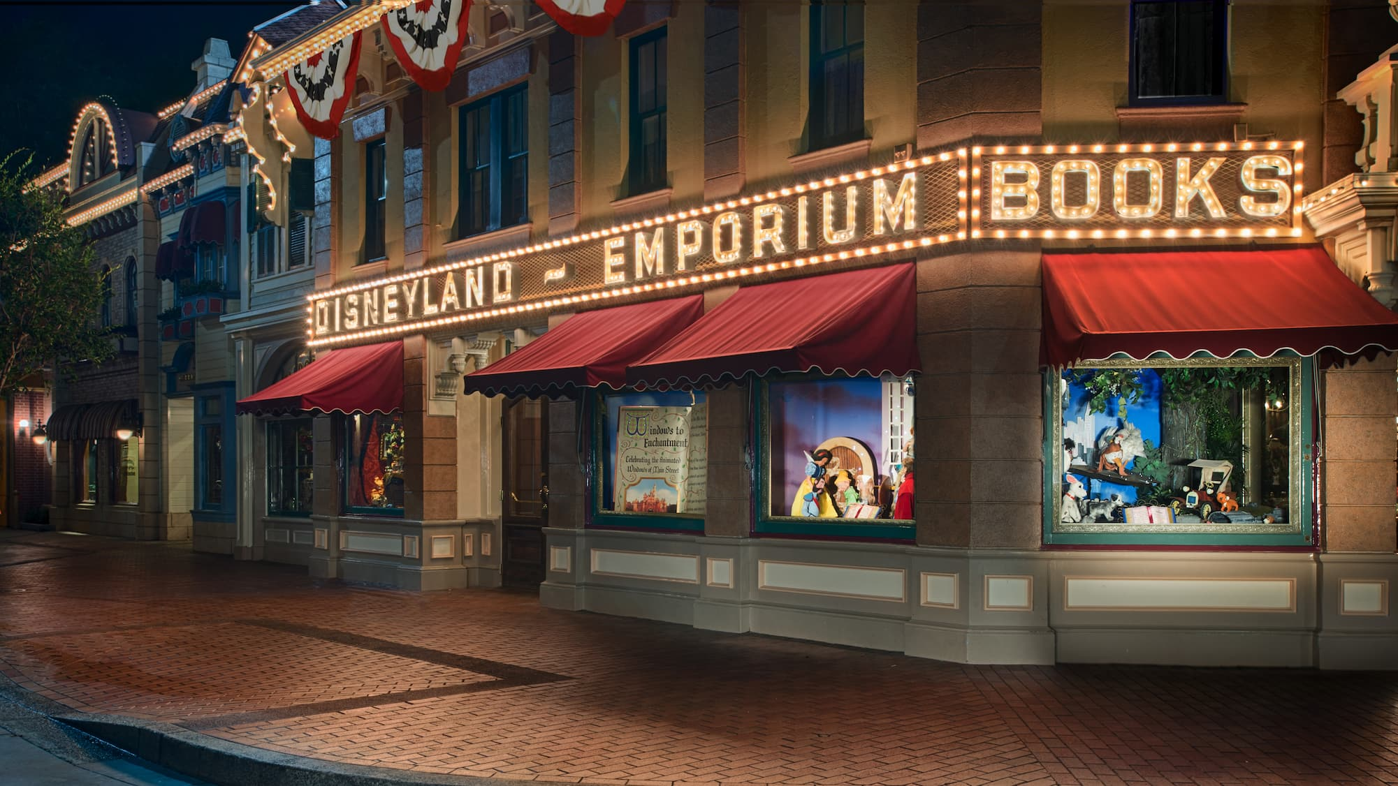 Patriotic flag banners cascade from the storefront as lights outside the Emporium illuminate the night